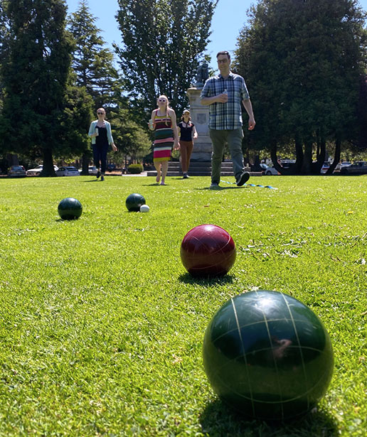Leap team members play bocce in the park.