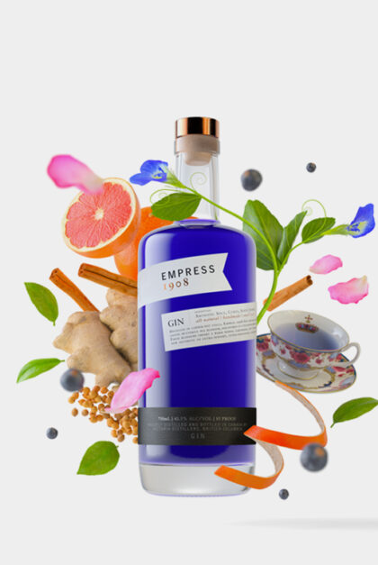 Botanicals swirl around a bottle of vivid blue Empress 1908 Gin.